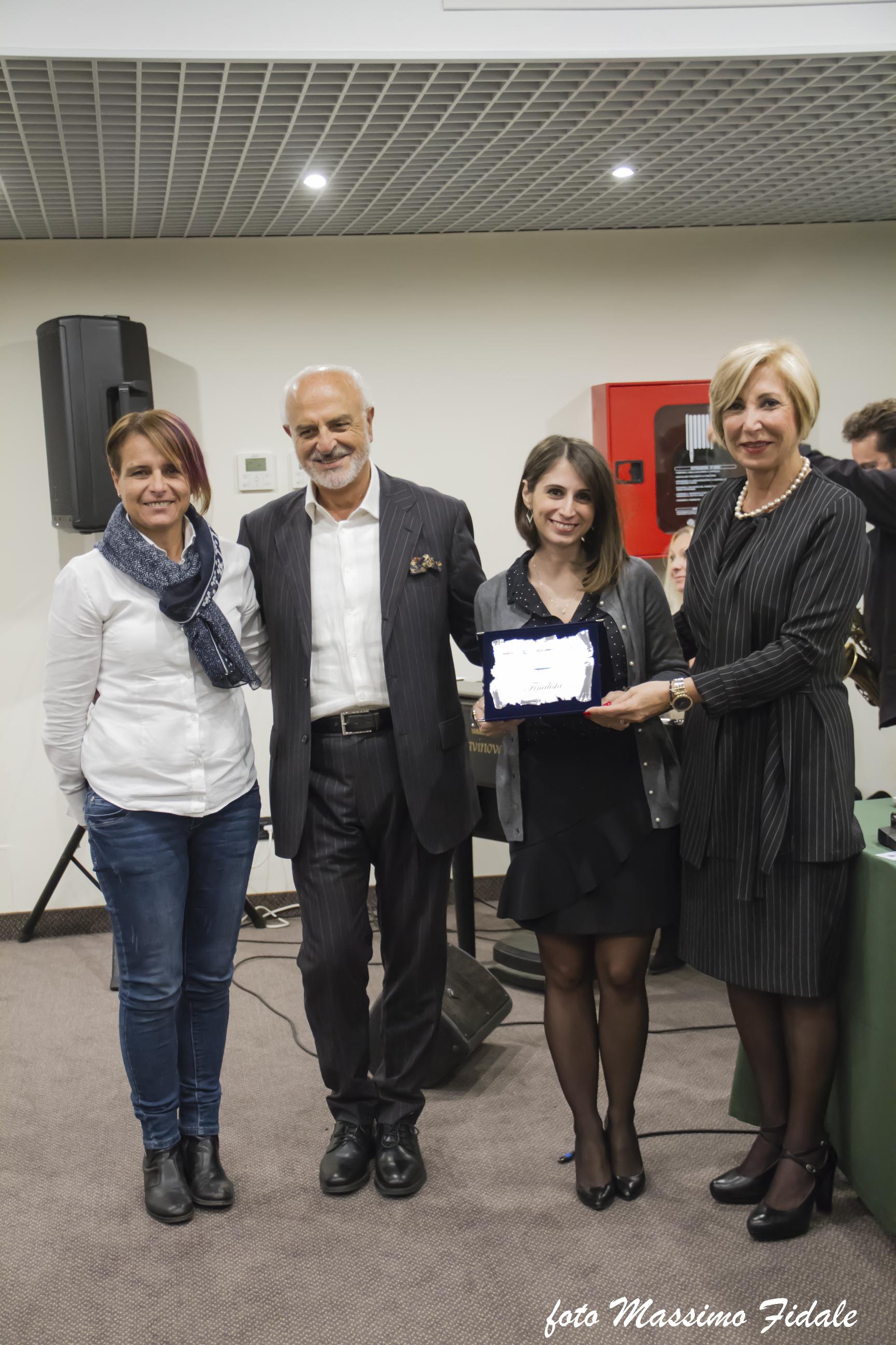 Anselmi, Califano, caruso premiano E. Rimolo, finalista